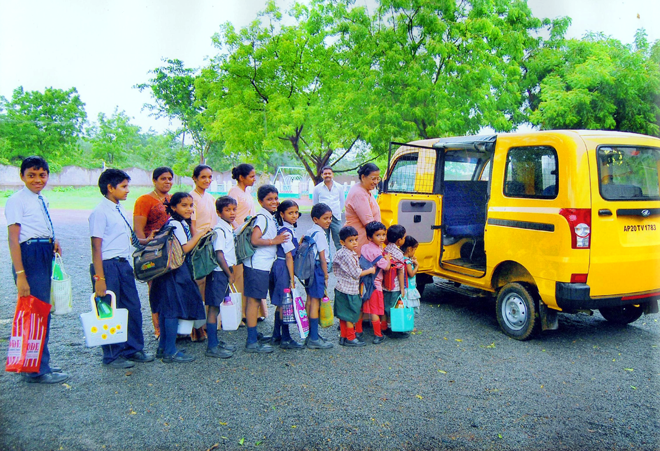 Image of children with the school buss